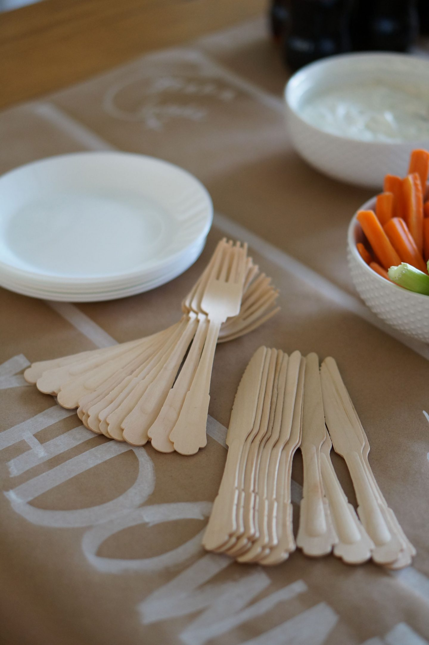 Popular North Carolina blogger Rebecca Lately shares a fun DIY table runner and football snacks for a simple and fun homegating party.