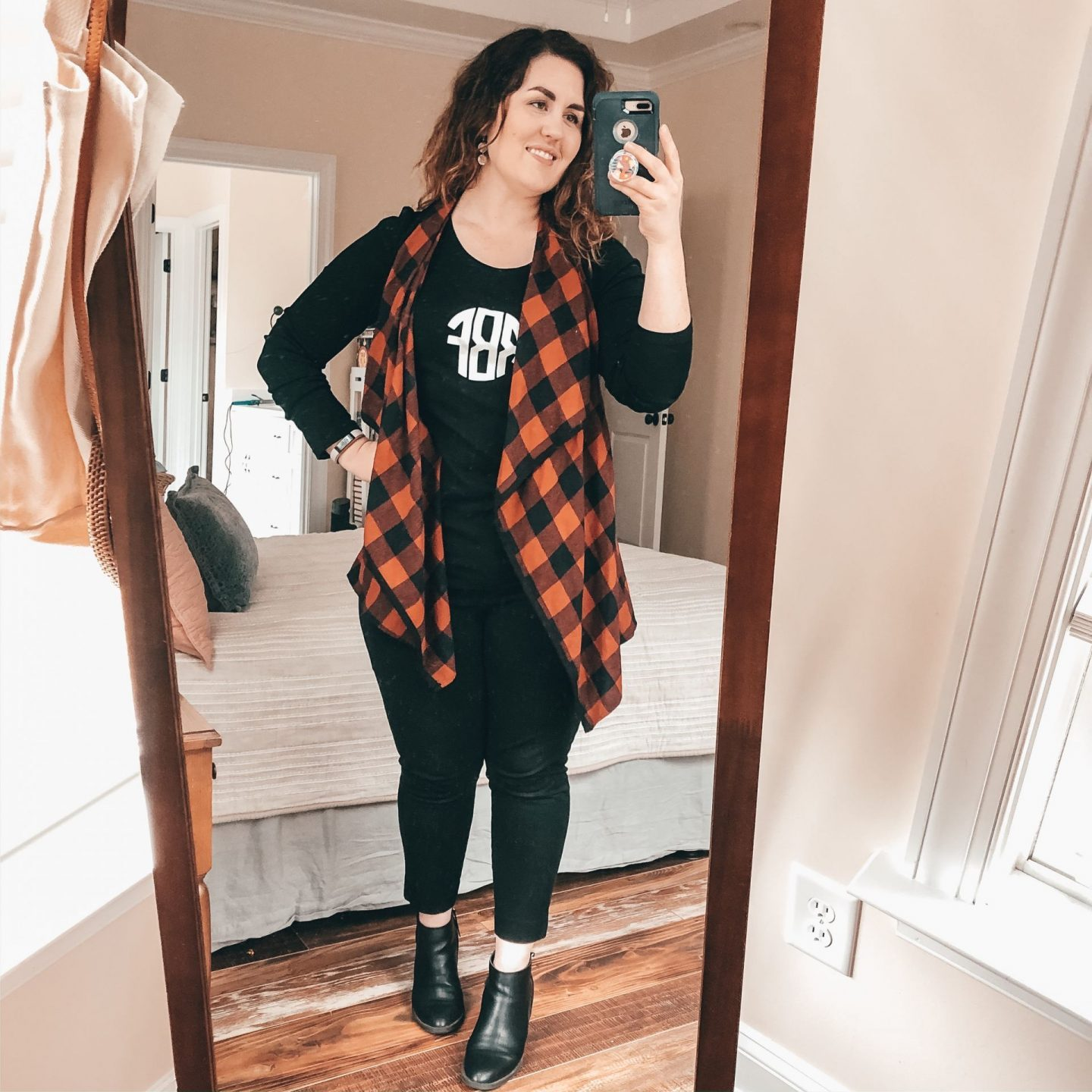 NC blogger Rebecca Lately shares how she styles black booties 3 ways. Stop on by for some outfit inspiration for autumn and winter!
